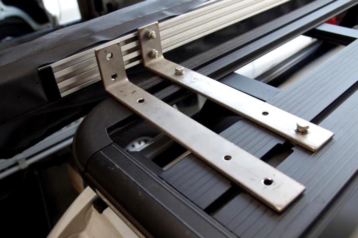 Fix awning brackets to frames