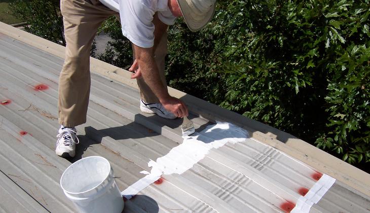 Coating roof seams