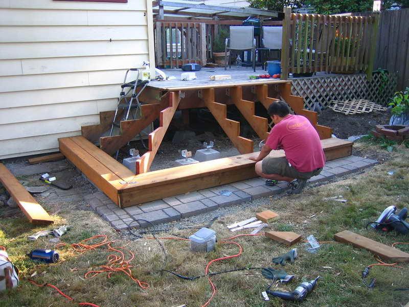 Man building deck steps
