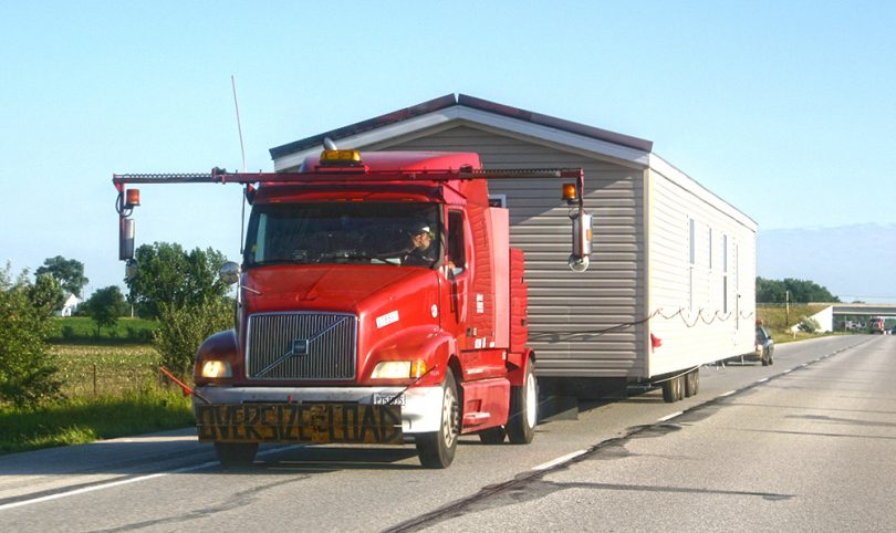 Modular home being transported