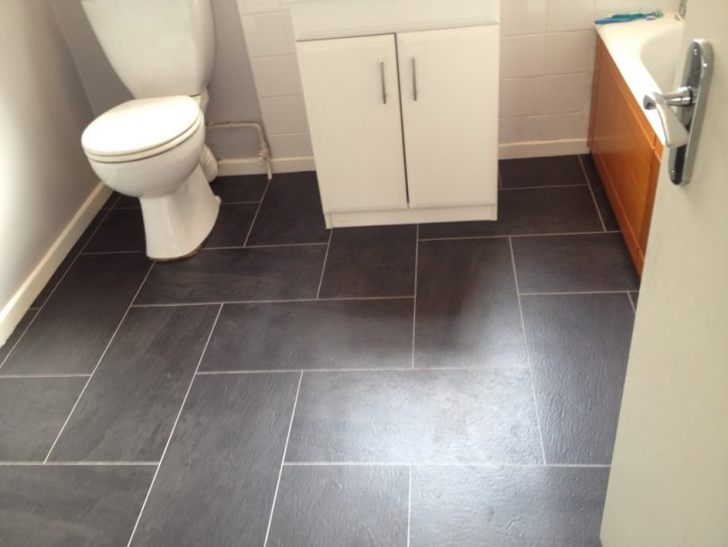 Grey linoleum bathroom floor