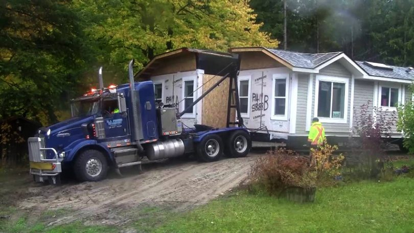 Truck carrying mobile home