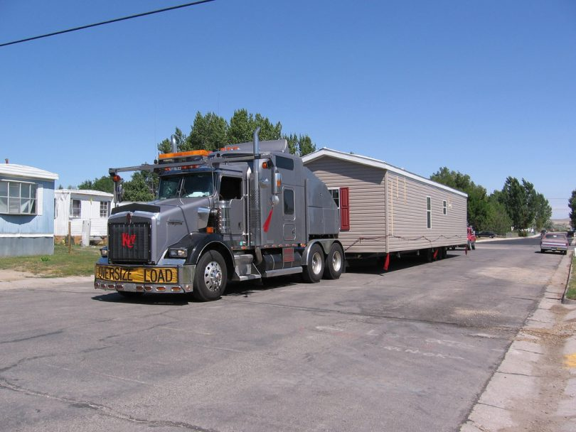 Truck moving mobile home