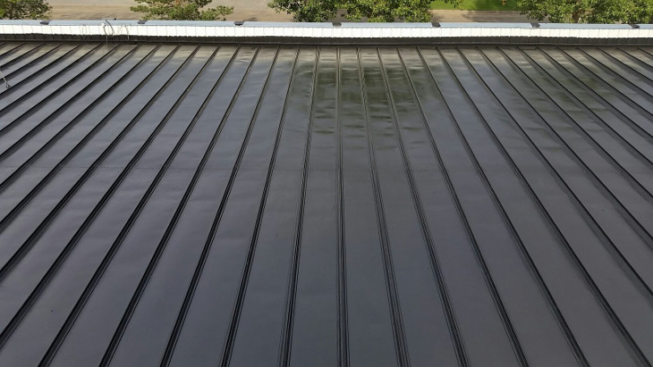 Drying newly applied roof sealant