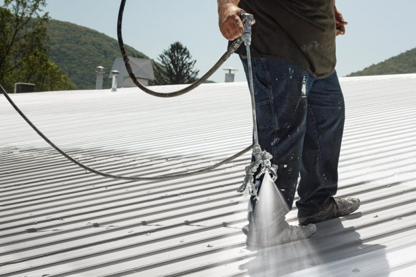 Spraying roof coating