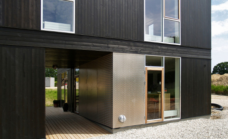 Low cost shipping container home