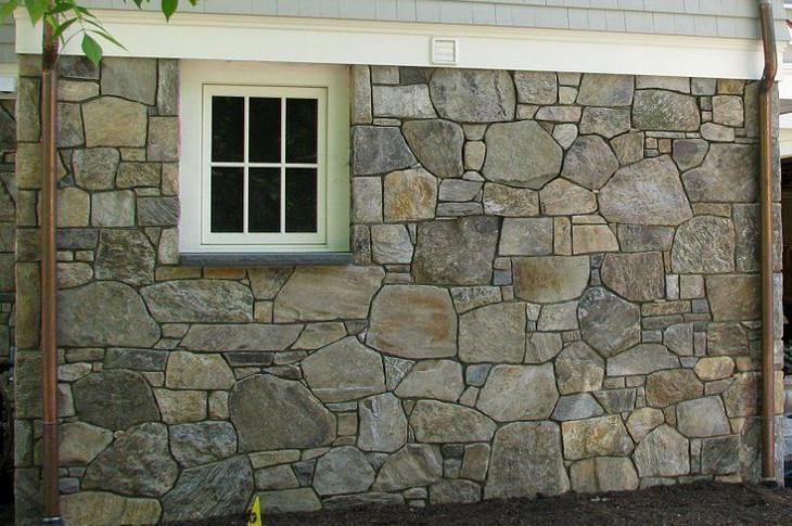 Simulated stone siding