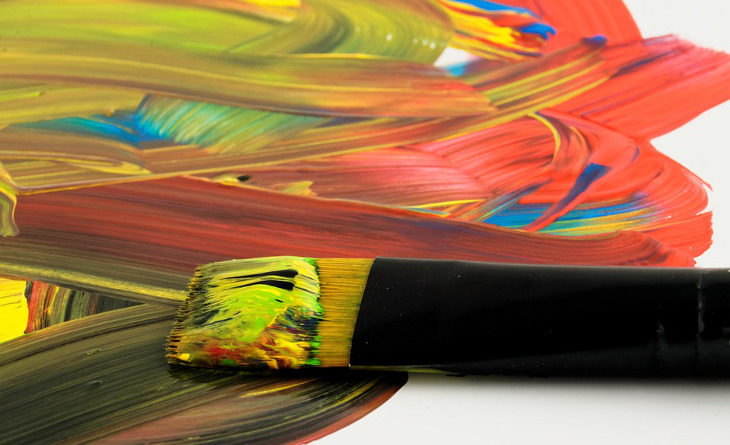 Acrylic paint and brush