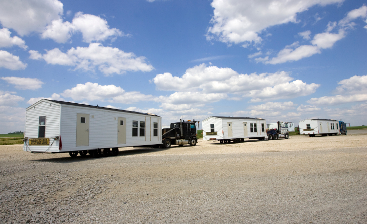 Mobile homes being transported