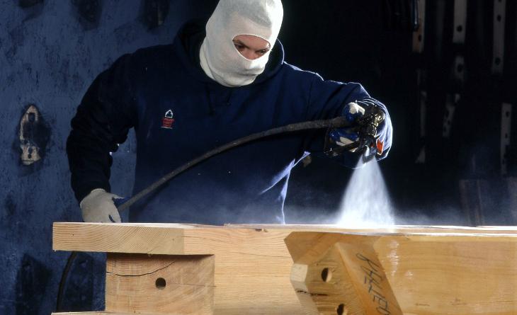 Worker spraying primer